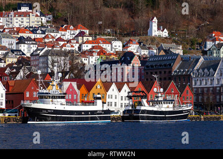 Fishing vessels / trawlers Havvon and Havfjord in the port of Bergen, Norway. Moored in front of Bryggen - Stock Photo