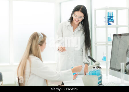 women scientists conducting research in the laboratory - Stock Photo