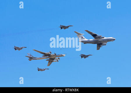 An Ilyushin Il-78 (Midas) tanker refueling a Tu-95 (Bear) strategic bomber flanked by MiG-29 (Fulcrum) jet fighters on Victory Day in Moscow, Russia - Stock Photo