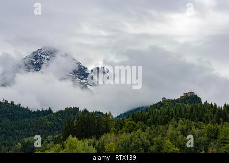 Castle ruin Ehrenberg with deciduous forest and mountains in the fog, Ehrenberg, Reutte, Ausserfern, Tyrol, Austria - Stock Photo
