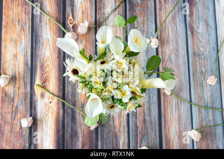 Floral arrangement of callas lilly and gerberas - Stock Photo