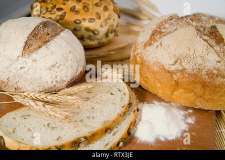 tasty and crispy fresh different kinds of bread with sour and wheat head - Stock Photo