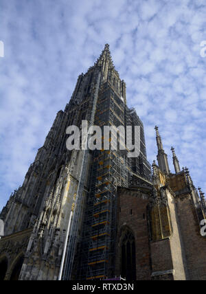 Ulm Minster exterior view from the west in front of blue sky covered with small clouds, tallest church of the world the minster of ulm abstract exteri