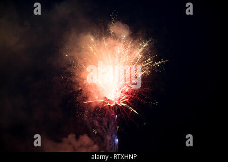 Fireworks color explosion on the sky. Celebrating New Year or 4th of July - Stock Photo