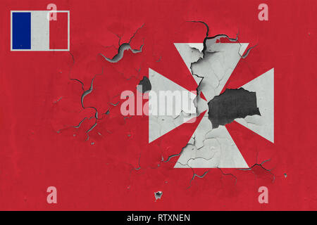 Close up grungy, damaged and weathered Wallis And Futuna flag on wall peeling off paint to see inside surface. - Stock Photo