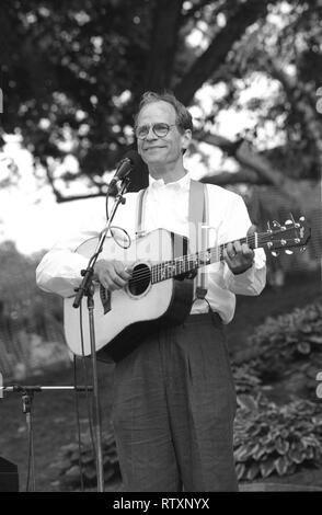Singer, songwriter and guitarist Livingston Taylor is shown performing on stage during 'live' concert appearance. - Stock Photo