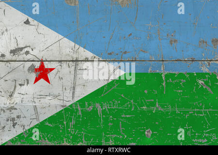 Grunge Djibouti flag on old scratched wooden surface. National vintage background. - Stock Photo