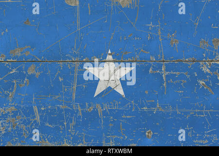 Grunge Somalia flag on old scratched wooden surface. National vintage background. - Stock Photo