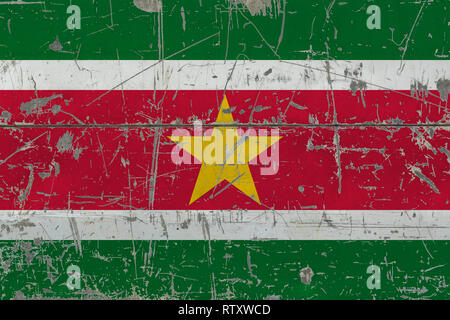 Grunge Suriname flag on old scratched wooden surface. National vintage background. - Stock Photo