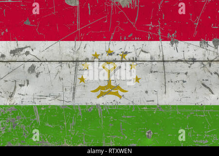 Grunge Tajikistan flag on old scratched wooden surface. National vintage background. - Stock Photo