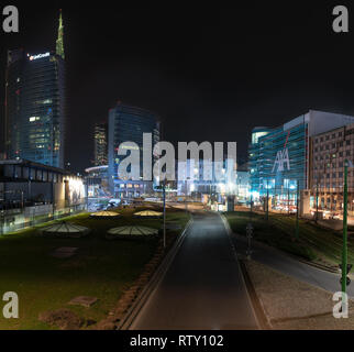 03/02/2019 Mialn, Italy: Unicredit tower, Gae Aulenti square, financial district of milan seen from the overpass Bussa.  nocturnal scene - Stock Photo