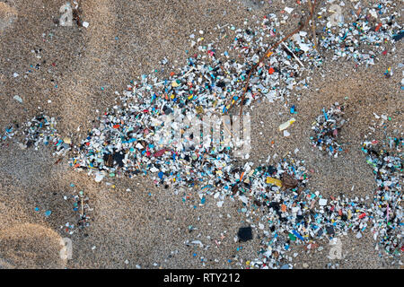 Corigliano Rossano, Italy, 02 March, 2019 -  A detail of microplastics along the Schiavonea beach, transported by the Ionian sea during the last sea s - Stock Photo