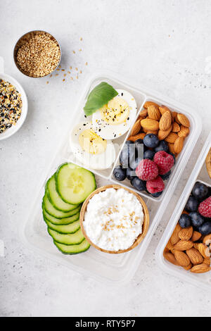 Lunch or snack box with high protein food, cottage cheese, nuts and eggs - Stock Photo