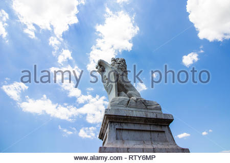 Pisa, Italy - May, 17, 2017: Ponte Solferino Lion statue on a bridge over the Arno river. - Stock Photo