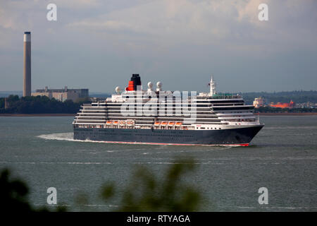 Luxury, travel, luxurious, wedding, honeymoon, suite, cabin, Queen Victoria cruise liner leaving Southampton,Pollution,Cowes Isle of Wight England UK - Stock Photo