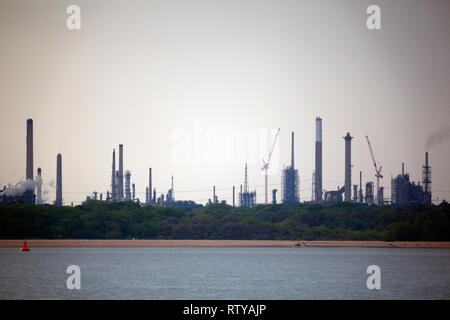 The Solent, Fawley,oil,refinery, cracking,towers,cranes,chimney,chimneys,flames, New Forest,Hampshire, Isle of Wight, England, UK, silhouette, - Stock Photo