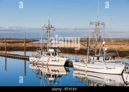 Commercial fishing boats docked in a narrow tidal inlet called Scotch Pond near Steveston British Columbia - Stock Photo