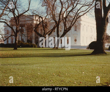 Vintage February 1985 photograph, view of the White House in Washington, DC, with a bucket truck removing the holiday garland. SOURCE: ORIGINAL PHOTOGRAPH - Stock Photo