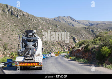 Stuck in a traffic queue at a Stop-Go control point for single lane driving due to roadworks in the Cogelmanskloof Pass, Langeberg Mountains, South Af - Stock Photo