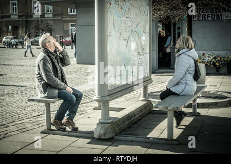 People studying a map in Krakow Poland - Stock Photo