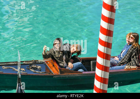 LAS VEGAS, NEVADA, USA - FEBRUARY 2019: Person taking a selfie on a gondola on the canal in front of the Italian themed Venetian Hotel in Las Vegas - Stock Photo