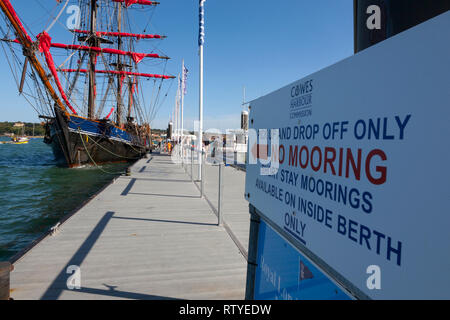 warning,sign,mooring,along,side, Trinity,Landing, seafront,parade,Cowes,isle of Wight,England,UK, - Stock Photo