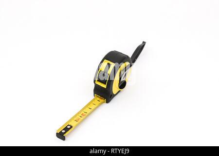 Yellow tape measure, measuring - Stock Photo