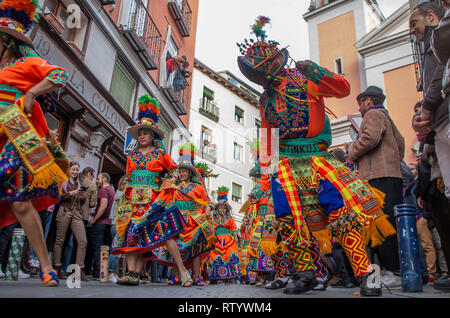 Madrid, Spain. 03rd Mar, 2019. A Carnival parade celebrating diversity took place at the neighbourhood of Lavapiés in Madrid, which is one of the most multicultural areas of the city. The parade ran trought the main streets of Lavapiés gathering hundreds of people of different cultures and social backgrounds.  In the picture, bolivian citizens showing some of the traditional dances of their country wearing folkloric clothes. Credit: Lora Grigorova/Alamy Live News - Stock Photo