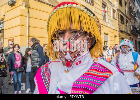 Madrid, Spain. 03rd Mar, 2019. Multicultural carnival on the streets of the neighbourhood of Lavapies. In the picture a mask of dancers of Peru Credit: Alberto Sibaja Ramírez/Alamy Live News - Stock Photo