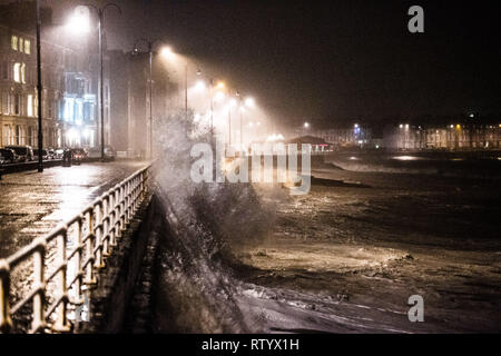 Aberystwyth, UK. 3rd March 2019.   UK Weather: Storm Freya, the latest named storm to hit the UK,  continues strikes with her full force against the promenade in  Aberystwyth on Sunday night. The Met Office has issued a yellow warning for much of the western parts of the UK, with gusts of  wind between 70 and 80mph forecast for exposed Irish Sea coasts tonight and into the early hours of Monday morning, with the risk of damage to property and severe injuries to people from flying debris.   Photo credit: Keith Morris /Alamy Live News - Stock Photo