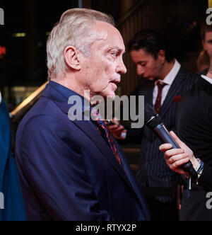 Berlin, Germany. 03rd Mar, 2019. Actor Udo Kier is interviewed on the red carpet for the film premiere of 'Iron Sky: The Coming Race'. Credit: Annette Riedl/dpa/Alamy Live News - Stock Photo