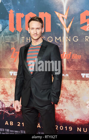 Berlin, Germany. 03rd Mar, 2019. Actor Vladimir Burlakov on the red carpet of the film premiere 'Iron Sky: The Coming Race'. Burlakov is the leading actor. Credit: Annette Riedl/dpa/Alamy Live News - Stock Photo
