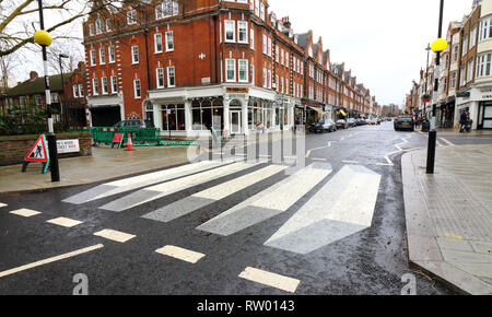 London, UK. 3rd Mar, 2019. UK's first '3D' zebra crossing has been painted on St John's Wood High Street as part of a 12-month trial. Westminster City Council are trialling it after road safety concerns from local residents and a local school. The cleverly painted stripes give the impression that approaching vehicles are about to drive over a ramp as the 3D effect works from either direction. Credit: Keith Mayhew/SOPA Images/ZUMA Wire/Alamy Live News - Stock Photo