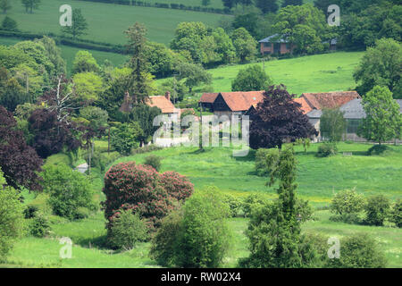 An English Rural Landscape in the Hambleden Valley in the Chiltern Hills with Farmhouse in the valley - Stock Photo