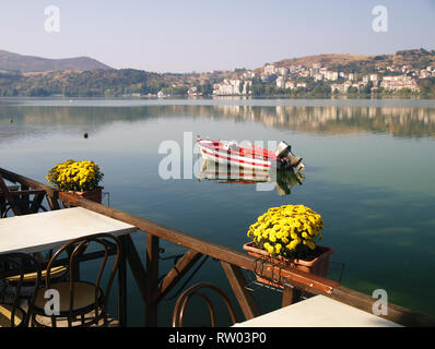 View of lake orestiada in Kastoria, Greece. Photo from a cafe  by the lake, in beautiful day light. - Stock Photo