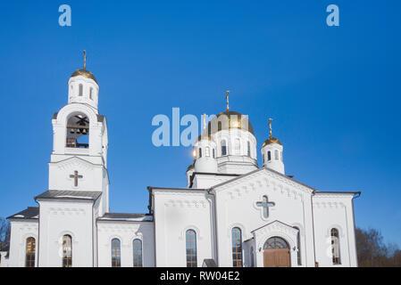 Eastern orthodox crosses on gold domes (cupolas) againts blue sky - Church, Khimki, Russia.