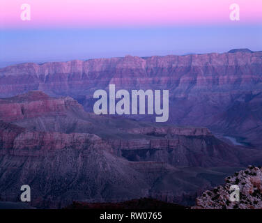 USA, Arizona, Grand Canyon National Park, Dawn sky over Colorado River and surrounding formations, view southeast from Cape Royal, North Rim. - Stock Photo