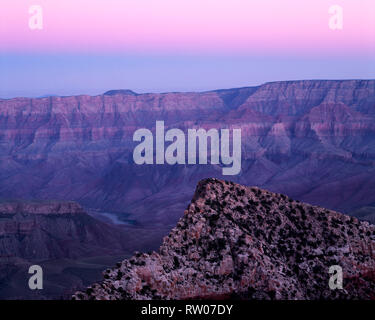 USA, Arizona, Grand Canyon National Park, Dawn sky over nearby Freya Castle and distant Colorado River, view southeast from Cape Royal, North Rim. - Stock Photo