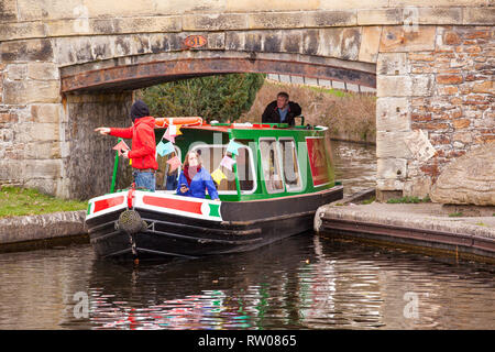 People men and women on a narrow boat on the Llangollen canal at Trevor basin near Wrexham North Wales - Stock Photo