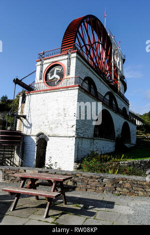 A visitor paying an entrance fee at the main visitorÕs entrance to the famous Laxey Wheel,  the world's greatest industrial water wheel. It is known f - Stock Photo
