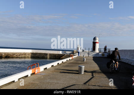 Laxey harbor breakwater lighthouse at the stone walled entrance in Laxey port, a few miles north of Douglas on the Isle of Man, Britain.   The Isle of - Stock Photo