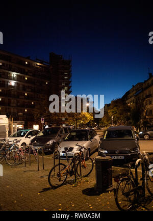 Strasbourg, France - Oct 13, 2018: Night view of HLM buildings habitation a loyer modere Esplanade district in Strasbourg with parked cars and bicycles - Stock Photo