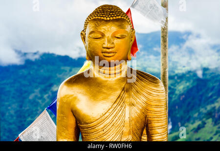 View on Buddha statue on top of little Adams peak in Ella, Sri Lanka - Stock Photo