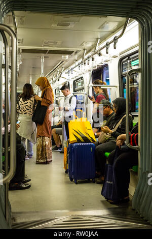 Passengers on the MRT (Mass Rapid Transit), Kuala Lumpur, Malaysia. - Stock Photo