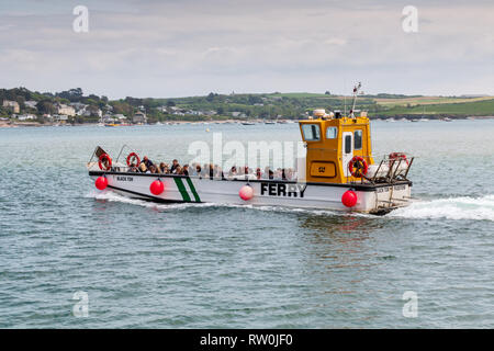 Padstow to Rock ferry boat filled with passengers crossing the Camel estuary towards Rock - Stock Photo