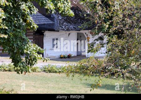 Old wooden white house in Lanckorona in Poland - Stock Photo