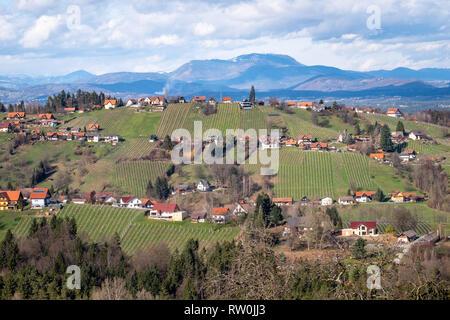 View from village Langegg over Schilcherland Stainz Weinstrasse vine route with vineyards and farm houses to mountain Schoeckl near Graz in Styria, Au - Stock Photo
