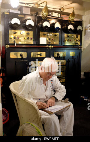 Engineer, in engine room, on , Paddle Steamer, Waverley, trip, round, the , Isle of Wight, England, UK, - Stock Photo
