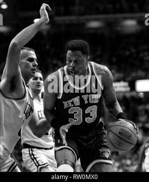 New York Knicks Patrick Ewing and Boston Celtics Eric Montross game action against the Boston Celtics at the Fleet Center in Boston Ma USA March 8,1995 photo by bill belknap - Stock Photo