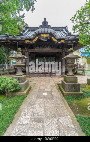 Setagaya, Tokyo, Japan - August 19, 2017: Moriiwao Temple. Awashimado hall devoted to Awashima-sama shinto deity who protects women from illness - Stock Photo